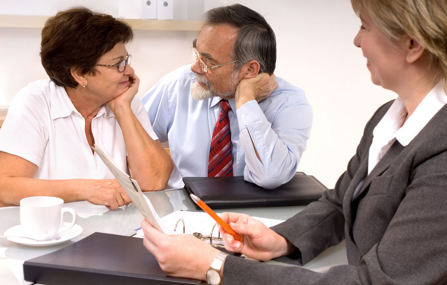 elderly couple with financial planner
